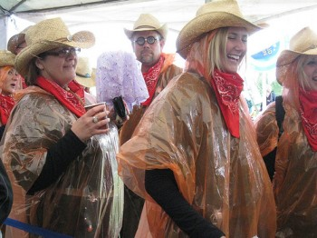 Cowgirls in raincoats, and one guy