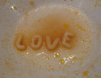 L O V E letters floating in alphabet soup