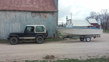 Me, my jeep, & Chris's new boat in downtown Loma